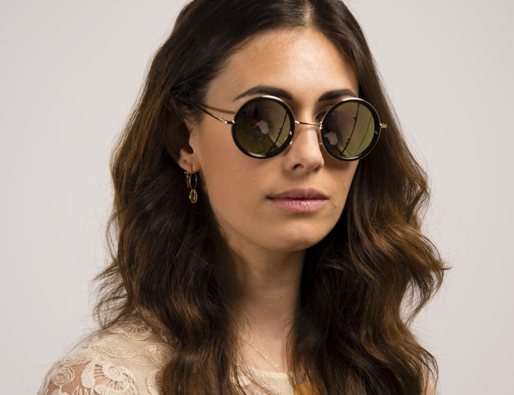 7a64c6dace4045 Gouden kunststof en metalen ronde zonnebril met gouden lens
